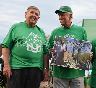 Former Marshall head coach, Jack Lengyel and assistant coach, Red Dawson honor Reggie Oliver on Saturday evening.  MARTY CONLEY/ FOR THE DAILY INDEPENDENT