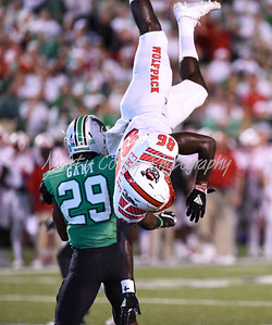 Marshall's Malik Gant up ends North Carolina State receiver Emeka Emezie on Saturday evening.  MARTY CONLEY/ FOR THE DAILY INDEPENDENT