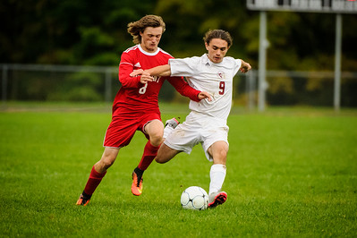 Varsity soccer between Belmont HS (red) and Derryfield (white) held on October 1, 2018 at the Belmont High School in Belmont, NH.