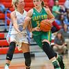 12-1-18<br /> Maconaquah vs Eastern girls basketball<br /> Eastern's McKenzie Cooper looks to keep the ball away from Mac's Ashley Jess.<br /> Kelly Lafferty Gerber | Kokomo Tribune