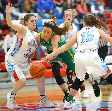 12-1-18<br /> Maconaquah vs Eastern girls basketball<br /> Eastern's Lilly Strunk looks to get past Mac's defense.<br /> Kelly Lafferty Gerber | Kokomo Tribune