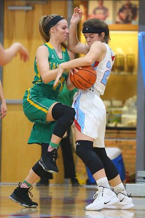 12-1-18<br /> Maconaquah vs Eastern girls basketball<br /> Eastern's Lilly Strunk goes for a shot as Mac's Alex Merritt puts up a block. <br /> Kelly Lafferty Gerber | Kokomo Tribune