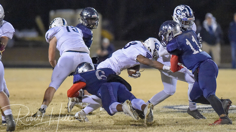 Grimsley's Cameron Wall (3) is tackled by East Forsyth's Kaleb Lundy (6) at Fred E. Lewis Stadium in Kernersville, North Carolina on Friday, November 30, 2018. (Photo by Robert Hill)