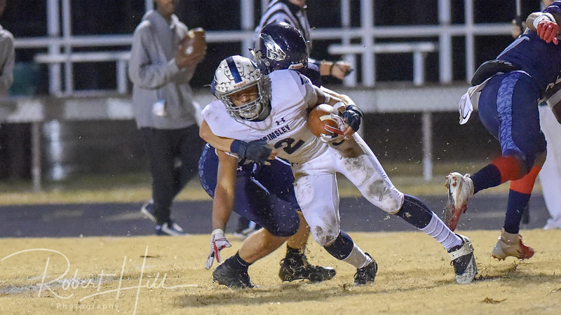 Grimsley's Born Lesane (2) is tackled by East Forsyth's Nathan Motsinger at Fred E. Lewis Stadium in Kernersville, North Carolina on Friday, November 30, 2018. (Photo by Robert Hill)