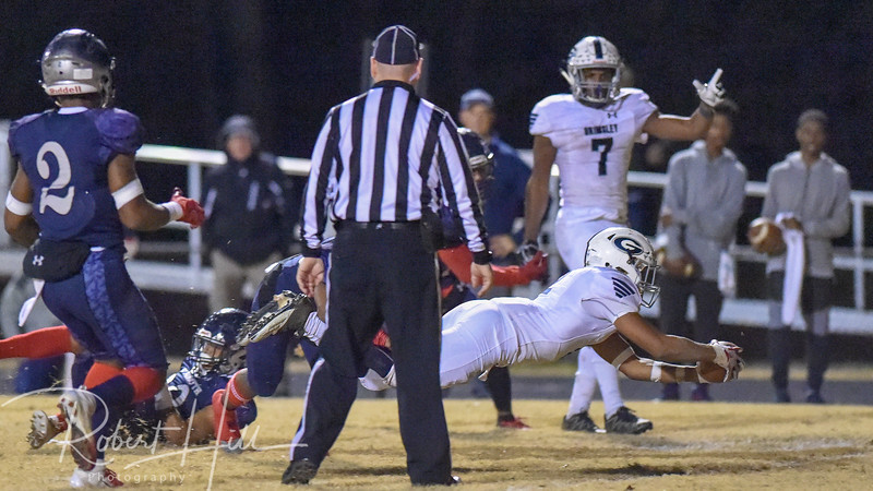 Grimsley's Born Lesane (2) scores a touchdown at Fred E. Lewis Stadium in Kernersville, North Carolina on Friday, November 30, 2018. (Photo by Robert Hill)