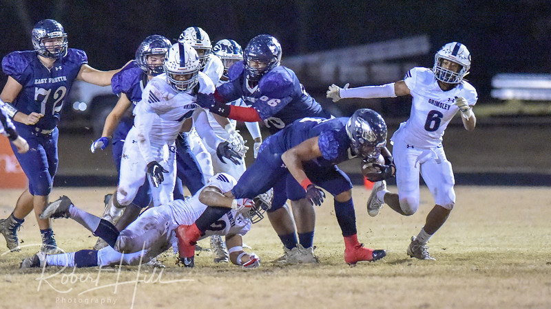 East Forsyth's Ahmani Marshall (1) is being tackled by Grimsley's Born Lesane (2) at Fred E. Lewis Stadium in Kernersville, North Carolina on Friday, November 30, 2018. (Photo by Robert Hill)