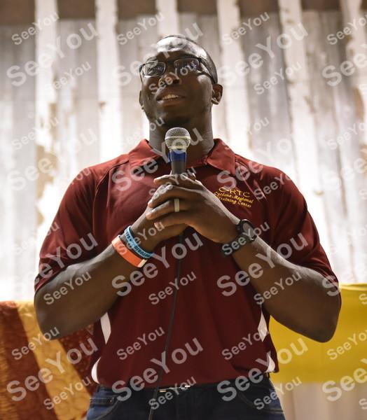 -Messenger photo by Britt Kudla<br /> Kyven Gadson of C-Rtc Athlete speak to the crowd during Iowa State Fundraiser on Saturday