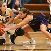 1-10-18<br /> Northwestern vs Oak Hill girls basketball<br /> Sarah Vas goes after a ball with Oak Hill's Jennessa Hasty.<br /> Kelly Lafferty Gerber | Kokomo Tribune