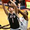 1-26-18<br /> Kokomo vs Lafayette Jeff boys basketball<br /> Lafayette Jeff's Maximus Grimes pulls down a rebound over Kokomo's Shemar Robinson.<br /> Kelly Lafferty Gerber | Kokomo Tribune