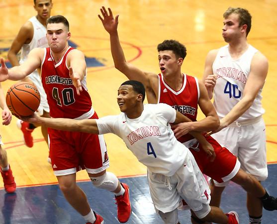 1-16-18<br /> Kokomo vs Logansport boys basketball<br /> Trajan Deckard goes after a rebound with Logansport defenders Jacob Cox and Elijah Crowe.<br /> Kelly Lafferty Gerber | Kokomo Tribune