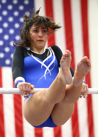 1-20-18<br /> Northwestern-Western gymnastics<br /> Western's Katie Devine on the bars.<br /> Kelly Lafferty Gerber | Kokomo Tribune