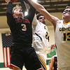 1-30-18<br /> Eastern vs Taylor boys basketball<br /> Taylor's Cassius Kelley-Smalley puts up a shot.<br /> Kelly Lafferty Gerber | Kokomo Tribune