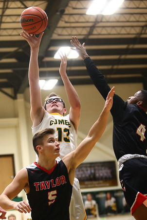1-30-18<br /> Eastern vs Taylor boys basketball<br /> Eastern's Nolan Smalley puts up a shot over Taylor defenders.<br /> Kelly Lafferty Gerber | Kokomo Tribune