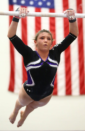1-20-18<br /> Northwestern-Western gymnastics<br /> NW's Catie Smith on the bars.<br /> Kelly Lafferty Gerber | Kokomo Tribune