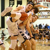 1-19-18<br /> Western vs Maconaquah boys basketball<br /> Western's Conner Linn grabs the rebound within a horde of players.<br /> Kelly Lafferty Gerber | Kokomo Tribune