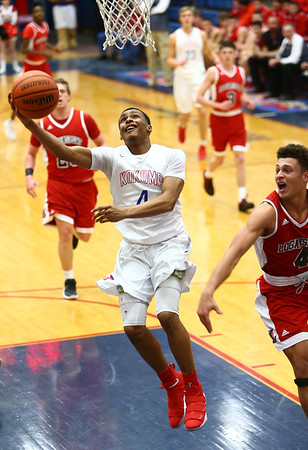1-16-18<br /> Kokomo vs Logansport boys basketball<br /> Trajan Deckard puts up a shot.<br /> Kelly Lafferty Gerber | Kokomo Tribune