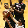 1-26-18<br /> Kokomo vs Lafayette Jeff boys basketball<br /> Alex Cotton grabs the rebound from Kokomo's Nate Hemmerich with the help of teammate James Burns.<br /> Kelly Lafferty Gerber | Kokomo Tribune