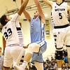 1-19-18<br /> Western vs Maconaquah boys basketball<br /> Ethan Larason, center, grabs a rebound from Western's Brayden Green, left, and Avery Hayes.<br /> Kelly Lafferty Gerber | Kokomo Tribune