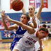 1-25-18<br /> Kokomo vs Tipton girls basketball<br /> Tipton's Cassidy Crawford looks to grab a rebound as Kokomo's Olivia Eddington and Brittany Barnard try to put up the block.<br /> Kelly Lafferty Gerber | Kokomo Tribune