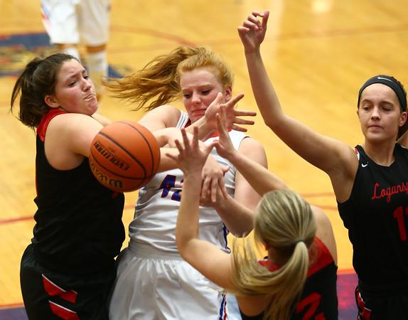 1-16-18<br /> Kokomo vs Logansport girls basketball<br /> Madison Wood grapples with Logansport defenders for a rebound.<br /> Kelly Lafferty Gerber | Kokomo Tribune