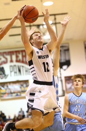 1-19-18<br /> Western vs Maconaquah boys basketball<br /> Cooper O'Neal goes up for a basket.<br /> Kelly Lafferty Gerber | Kokomo Tribune