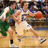 1-5-18<br /> Tipton vs Yorktown boys basketball<br /> Tipton's Carson Dolezal dribbles down the court.<br /> Kelly Lafferty Gerber | Kokomo Tribune