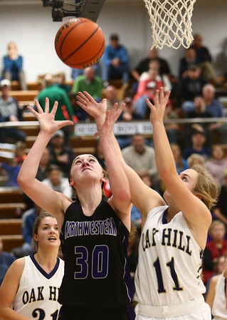 1-10-18<br /> Northwestern vs Oak Hill girls basketball<br /> NW's Steph Burns and Oak Hill's Kristin Dubois go after a rebound.<br /> Kelly Lafferty Gerber | Kokomo Tribune
