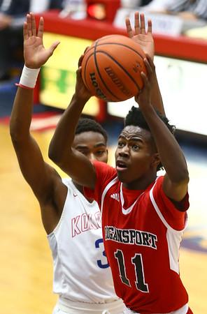 1-16-18<br /> Kokomo vs Logansport boys basketball<br /> Will Penny looks to the basket for a shot.<br /> Kelly Lafferty Gerber | Kokomo Tribune
