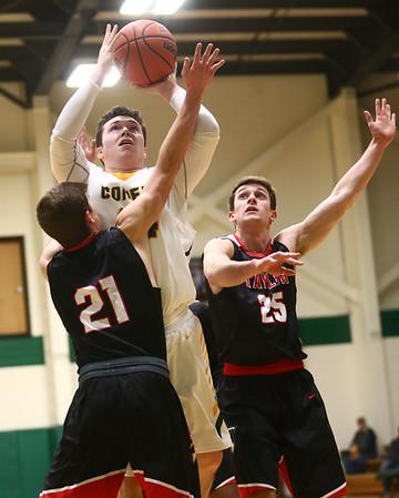 1-30-18<br /> Eastern vs Taylor boys basketball<br /> Eastern's Sam Querry puts up a shot over Taylor defenders.<br /> Kelly Lafferty Gerber | Kokomo Tribune