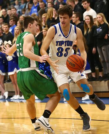 1-5-18<br /> Tipton vs Yorktown boys basketball<br /> Tipton's Trent Seward dribbles around Yorktown defense.<br /> Kelly Lafferty Gerber | Kokomo Tribune