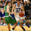 1-5-18<br /> Tipton vs Yorktown boys basketball<br /> Tipton's Trent Seward dribbles around Yorktown defense.<br /> Kelly Lafferty Gerber | Kokomo Tribune