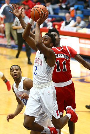 1-16-18<br /> Kokomo vs Logansport boys basketball<br /> Shemar Robinson goes for the basket.<br /> Kelly Lafferty Gerber | Kokomo Tribune