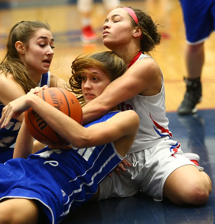1-25-18<br /> Kokomo vs Tipton girls basketball<br /> Tipton's Rachael Ressler and Cassidy Crawford (center) grab a loose ball in a scramble with Kokomo's Olivia Eddington.<br /> Kelly Lafferty Gerber | Kokomo Tribune