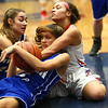 1-25-18<br /> Kokomo vs Tipton girls basketball<br /> Tipton's Rachael Ressler and Cassidy Crawford (center) grab a loose ball in a scramble with Kokomo's Olivia Eddington.<br /> Kelly Lafferty Gerber | Kokomo Tribune