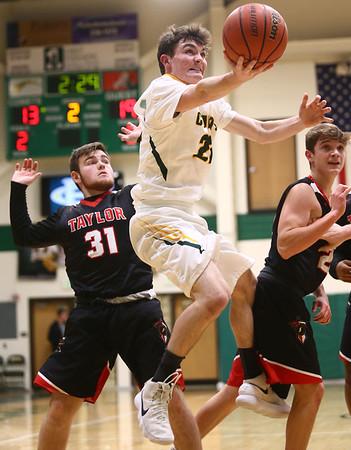 1-30-18<br /> Eastern vs Taylor boys basketball<br /> Eastern's Ethan Henry puts up a shot.<br /> Kelly Lafferty Gerber | Kokomo Tribune
