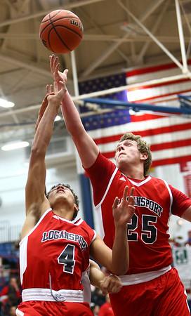 1-16-18<br /> Kokomo vs Logansport boys basketball<br /> Logan's Elijah Crowe and Tucker Platt go after a rebound.<br /> Kelly Lafferty Gerber | Kokomo Tribune