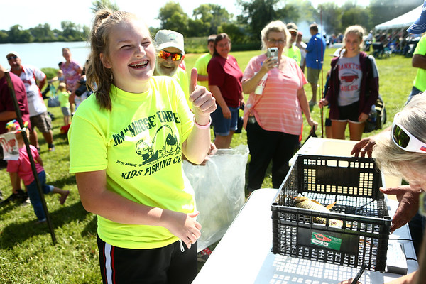 7-28-18<br /> Kids Fishing Clinic<br /> Shelby Anderson gives the thumbs up at the weigh-in during the Kids Fishing Clinic on Saturday morning.<br /> Kelly Lafferty Gerber | Kokomo Tribune