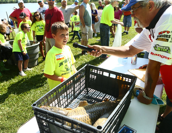 7-28-18<br /> Kids Fishing Clinic<br /> Nolan Ingram is interviewed at the weigh-in about his 14-pound fish he caught during the Kids Fishing Clinic on Saturday morning.<br /> Kelly Lafferty Gerber   Kokomo Tribune