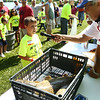 7-28-18<br /> Kids Fishing Clinic<br /> Nolan Ingram is interviewed at the weigh-in about his 14-pound fish he caught during the Kids Fishing Clinic on Saturday morning.<br /> Kelly Lafferty Gerber | Kokomo Tribune