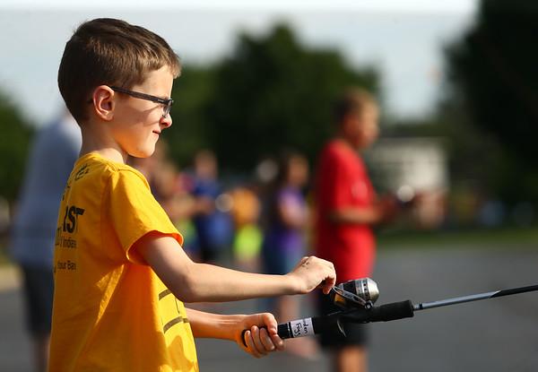 Jarrden Fogg, 9, practices casting during the Kids Fishing clinic on Thursday, July 19, 2018.<br /> Kelly Lafferty Gerber | Kokomo Tribune