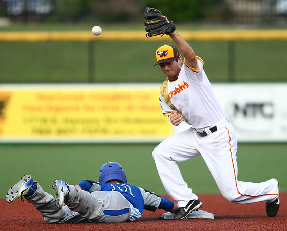 7-14-18<br /> Jackrabbits vs Rex<br /> Neil Lambert misses the throw to second in an attempt to get Rex 11 out.<br /> Kelly Lafferty Gerber | Kokomo Tribune