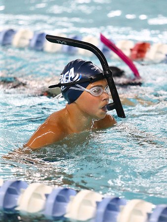 Cooper Deck, 12, uses a snorkel as he does the reverse freestyle during Howard County Aquatics swim practice on Thursday, July 19, 2018.<br /> Kelly Lafferty Gerber | Kokomo Tribune