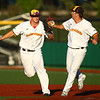 7-24-18<br /> Jackrabbits vs Aviators<br /> First baseman Jacob Buchberger, left, and pitcher Chandler Coates celebrate after working together for an out.<br /> Kelly Lafferty Gerber | Kokomo Tribune