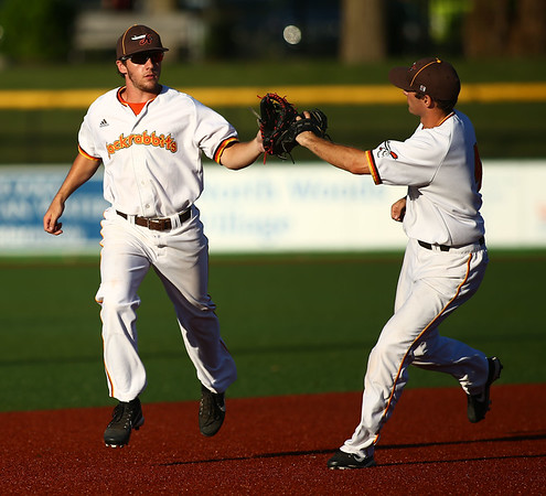 7-6-18<br /> Jackrabbits vs WV Miners<br /> Nick Brunson, left, and Neil Lambert celebrate after making a double play.<br /> Kelly Lafferty Gerber | Kokomo Tribune