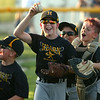 6-15-18<br /> Minor League Championship between Hearn Dental and Jarrell Orthodontics<br /> Canaan Horner cheers, surrounded by teammates, as he holds the ball he caught for the third out and ending the game.<br /> Kelly Lafferty Gerber | Kokomo Tribune
