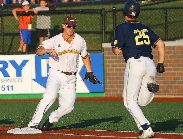 The Kokomo Jackrabbits opening game against the Lafayette Aviators on June 4, 2018. A hit down the first base line is an easy out by Jackrabbits firstbaseman Garett Simmons in he 5th inning.<br /> Tim Bath   Kokomo Tribune