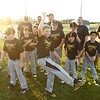 6-15-18<br /> Minor League Championship between Hearn Dental and Jarrell Orthodontics<br /> Bryce Jacobs, center, dances with other teammates from Hearn Dental after their win.<br /> Kelly Lafferty Gerber | Kokomo Tribune
