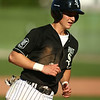 6-13-18<br /> Post Six baseball vs Napoleon<br /> Wynn Takacs rounds third and heads for home to score a run.<br /> Kelly Lafferty Gerber | Kokomo Tribune
