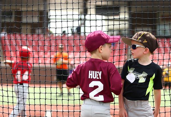 Rylan Huey, 6, left, and Camden Woods, 6, chat behind the net as fellow Jackrabbits kids baseball camp participants work on batting on Wednesday, June 27, 2018.<br /> Kelly Lafferty Gerber | Kokomo Tribune