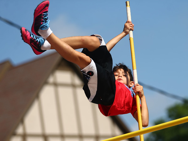 Isaac Roman, 9, competes in the pole vault during the Haynes Apperson Sports Festival on Saturday, June 30, 2018.<br /> Kelly Lafferty Gerber | Kokomo Tribune